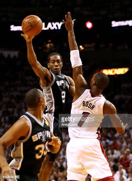 Kawhi Leonard passes to Boris Diaw of the San Antonio Spurs as Chris Bosh of the Miami Heat defends during Game Three of the 2014 NBA Finals at...