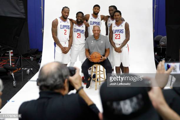 Kawhi Leonard, Patrick Beverley, Paul George, Head Coach Doc Rivers, Montrezl Harrell and Lou Williams of the LA Clippers pose for a photograph...