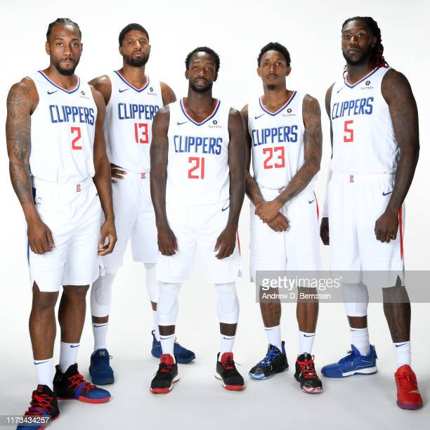Kawhi Leonard, Paul George, Patrick Beverley, Lou Williams, and Montrezl Harrell of the LA Clippers pose for a portrait during media day on September...
