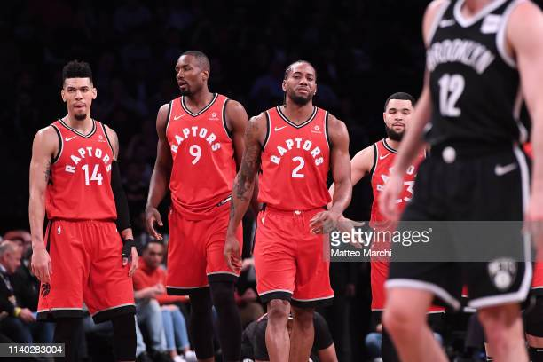 Kawhi Leonard Serge Ibaka Danny Green and Fred VanVleet of the Toronto Raptors during the game against the Brooklyn Nets at Barclays Center on April...