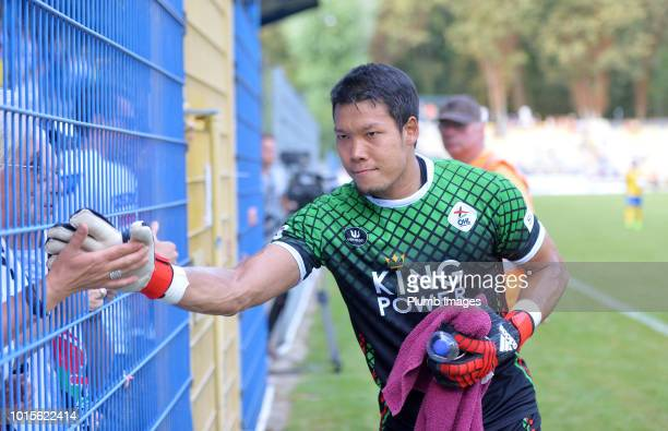 Kawin Thamsatchanan of OH Leuven high fives a travelling fan after the Proximus League match between Royal Union SaintGilloise and OH Leuven at Stade...