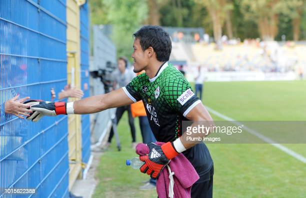 Kawin Thamsatchanan of OH Leuven shakes hands with a travelling fan after the Proximus League match between Royal Union SaintGilloise and OH Leuven...