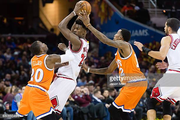 Kay Felder and Jordan McRae of the Cleveland Cavaliers double team Jimmy Butler of the Chicago Bulls during the second half at Quicken Loans Arena on...