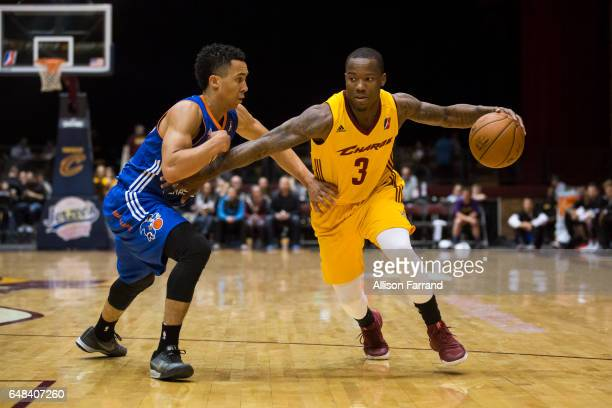 Kay Felder of the Canton Charge drives against Travis Trice II of the Westchester Knicks at the Canton Memorial Civic Center on March 5 2017 in...