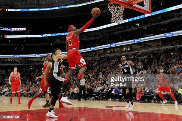 Kay Felder of the Chicago Bulls attempts a layup against the San Antonio Spurs in the second quarter at the United Center on October 21 2017 in...