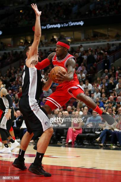 Kay Felder of the Chicago Bulls attempts a pass while being guarded by Joffrey Lauvergne of the San Antonio Spurs in the second quarter at the United...