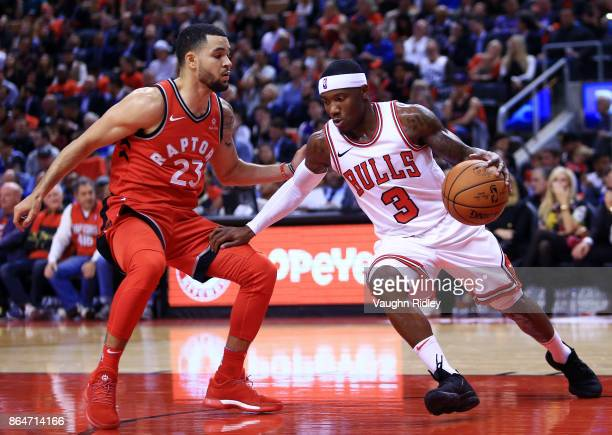 Kay Felder of the Chicago Bulls dribbles the ball as Fred VanVleet of the Toronto Raptors defends during to the second half of an NBA game at Air...
