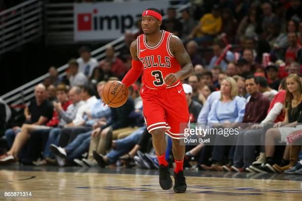 Kay Felder of the Chicago Bulls dribbles the ball in the first quarter against the San Antonio Spurs at the United Center on October 21 2017 in...
