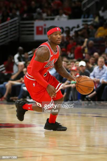 Kay Felder of the Chicago Bulls dribbles the ball in the second quarter against the San Antonio Spurs at the United Center on October 21 2017 in...
