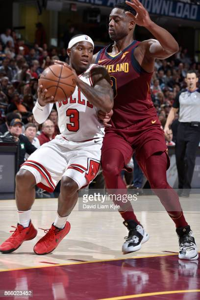 Kay Felder of the Chicago Bulls handles the ball against Dwyane Wade of the Cleveland Cavaliers on October 24 2017 at Quicken Loans Arena in...