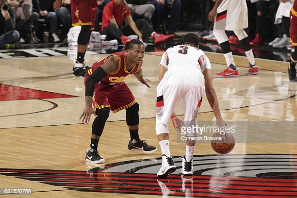 Kay Felder of the Cleveland Cavaliers plays defense against CJ McCollum of the Portland Trail Blazers during the game on January 11 2017 at the Moda...