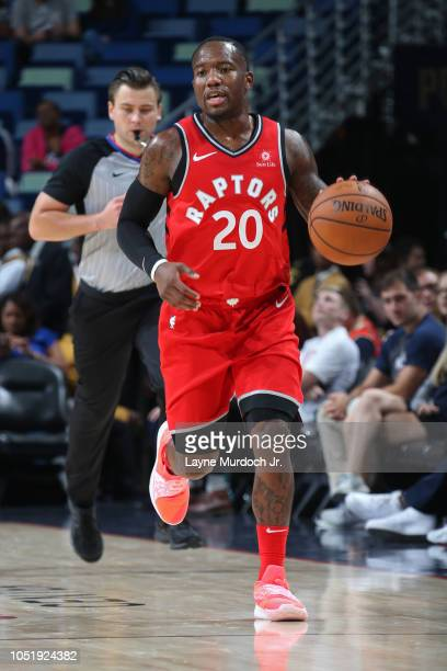 Kay Felder of the Toronto Raptors dribbles the ball up court against the New Orleans Pelicans during a preseason game on October 11 2018 at Smoothie...