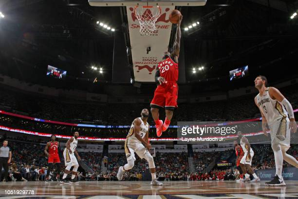 Kay Felder of the Toronto Raptors drives to the basket against the New Orleans Pelicans during a preseason game on October 11 2018 at Smoothie King...