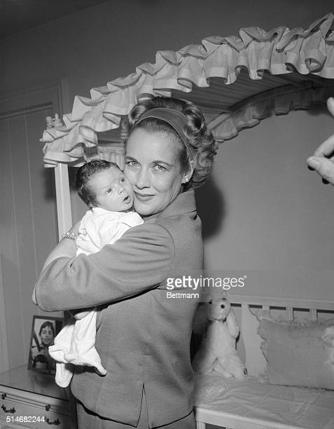 Kay Gable hugs her two week old baby John Clark Gable The baby son of the late actor Clark Gable was born in the very hospital where Gable died four...