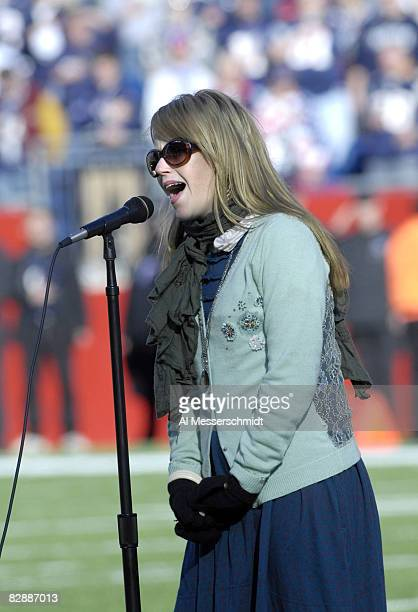 Kay Hanley sings the National Anthem as the New England Patriots host the New York Jets in an NFL wild card playoff game Jan 7 2007 in Foxborough The...