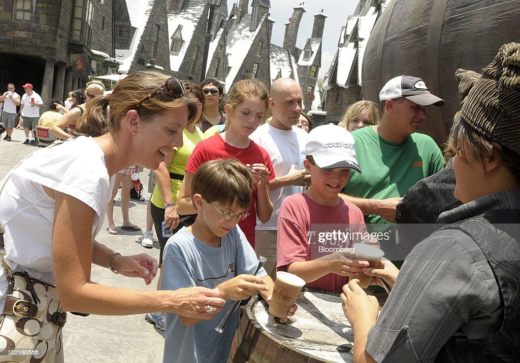 Kay Humble, left, of Atlanta, Georgia, U.S., purchases Butterbeer for her children Jack, center, 7, and Andrew, 9, at the Universal Studios Wizarding World of Harry Potter theme park in Orlando, Florida, U.S., on Thursday, June 17, 2010. Universal reportedly spent $265 million building the theme park, based on a Securities & Exchange Commission filing. Photographer: Phelan M. Ebenhack/Bloomberg via Getty Images