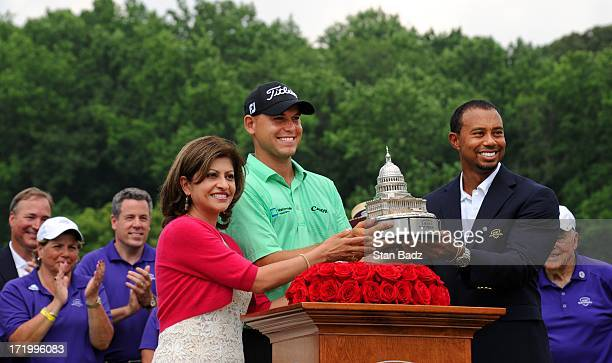 Kay Kapoor president of ATT Federal Bill Haas and Tiger Woods pose with the trophy after Haas won the ATT National at Congressional Country Club on...