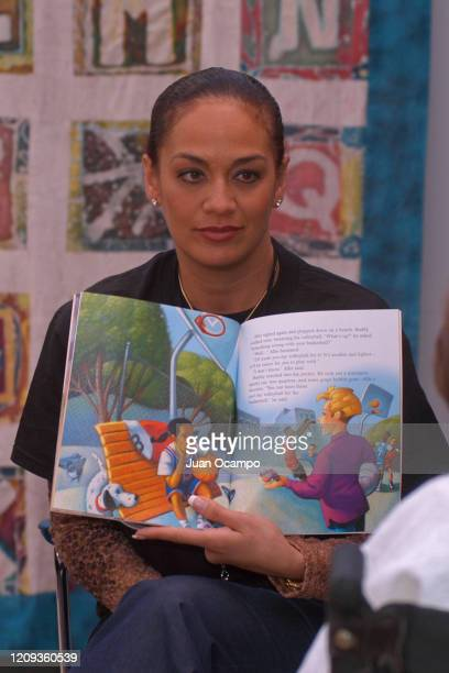 Kay Malone reads to children during a Read to Achieve Hospital Visit as part of 2004 NBA All Star Weekend on February 9 2004 in Los Angeles...