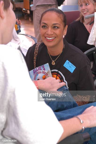 Kay Malone speaks to children during a Read to Achieve Hospital Visit as part of 2004 NBA All Star Weekend on February 9 2004 in Los Angeles...