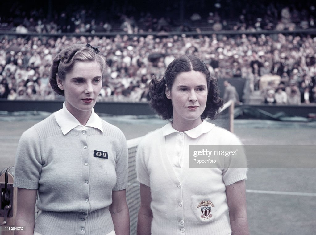 Kay Stammers (left) of Great Britain with Sarah Fabyan of the USA prior to their Wightman Cup match on Centre Court at Wimbledon, June 1938.