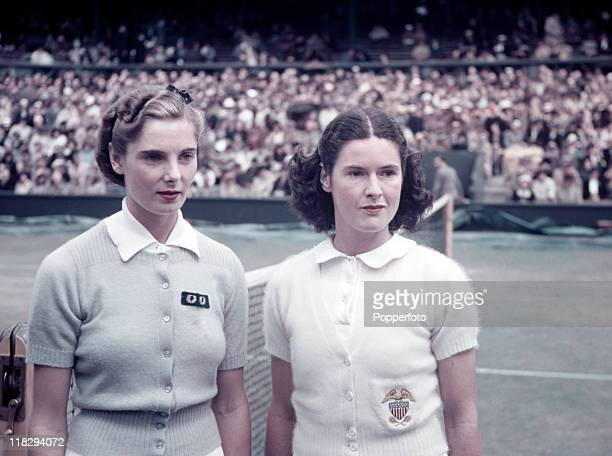 Kay Stammers of Great Britain with Sarah Fabyan of the USA prior to their Wightman Cup match on Centre Court at Wimbledon June 1938