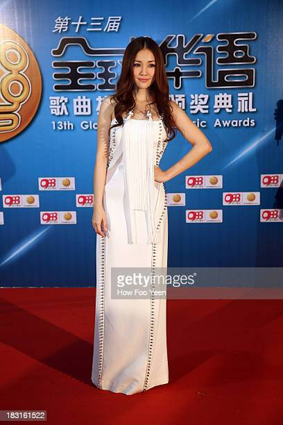 Kay Tse of Hong Kong poses during the red capet prior to the start of the 13th Global Chinese Music Awards at Putra Stadium on October 5 2013 in...