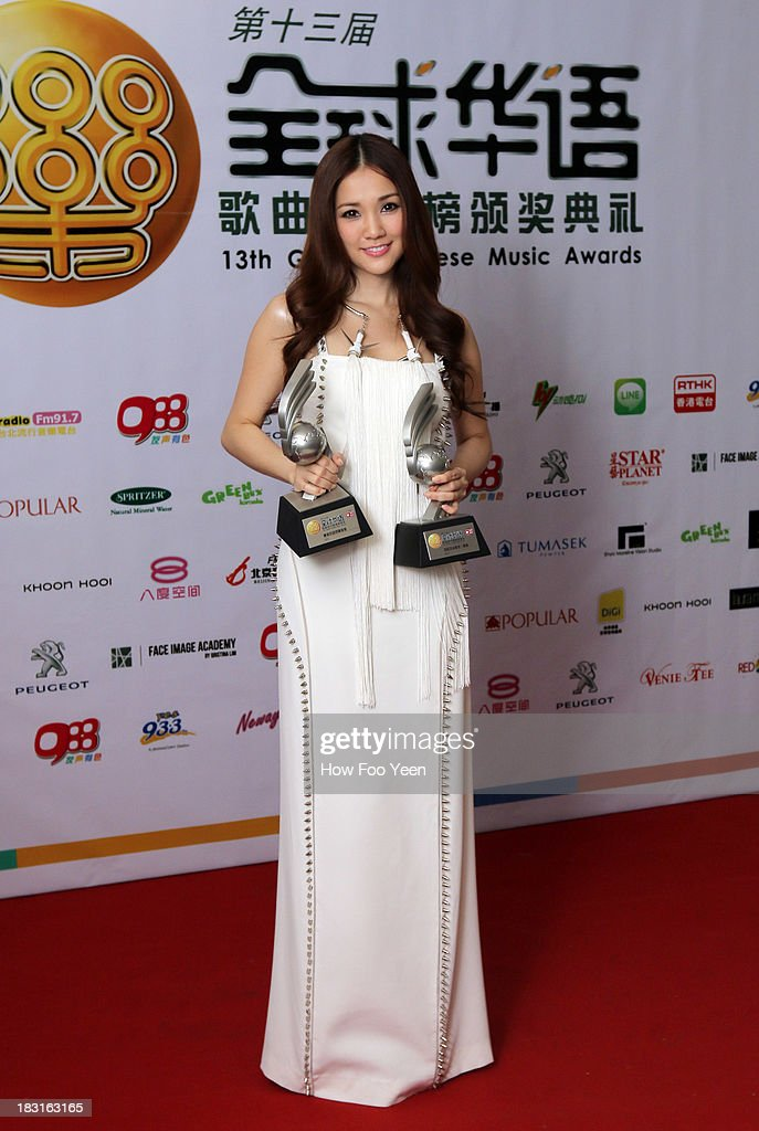 Kay Tse of Hong Kong poses with her Awards at back stage during the 13th Global Chinese Music Awards at Putra Stadium on October 5, 2013 in Kuala Lumpur, Malaysia.