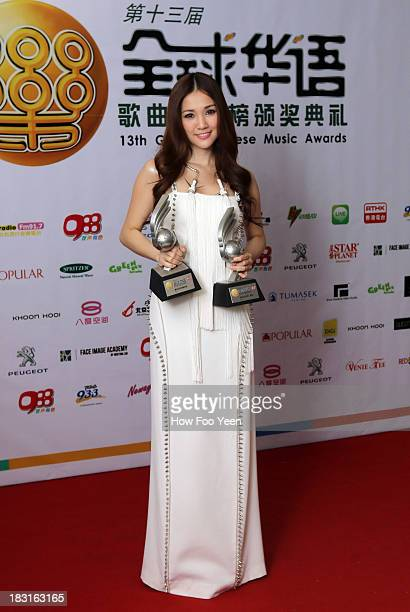 Kay Tse of Hong Kong poses with her Awards at back stage during the 13th Global Chinese Music Awards at Putra Stadium on October 5 2013 in Kuala...