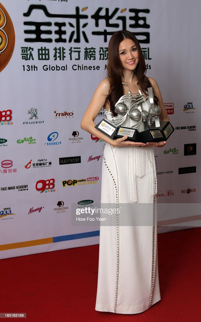 Kay Tse of Hong Kong poses with her numerous Awards at back stage during the 13th Global Chinese Music Awards at Putra Stadium on October 5, 2013 in Kuala Lumpur, Malaysia.