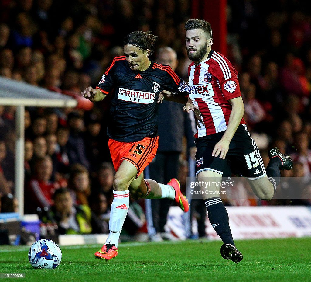 Kay Voser of Fulham looks to get past Brentford's Stuart Dallas during the Capital One Cup Second Round match between Brentford and Fulham at Griffin Park on August 26, 2014 in London, England.