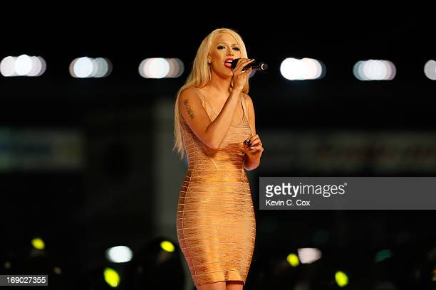 Kaya Jones sings the natinoal anthem during prerace ceremonies for the NASCAR Sprint Cup Series AllStar race at Charlotte Motor Speedway on May 18...
