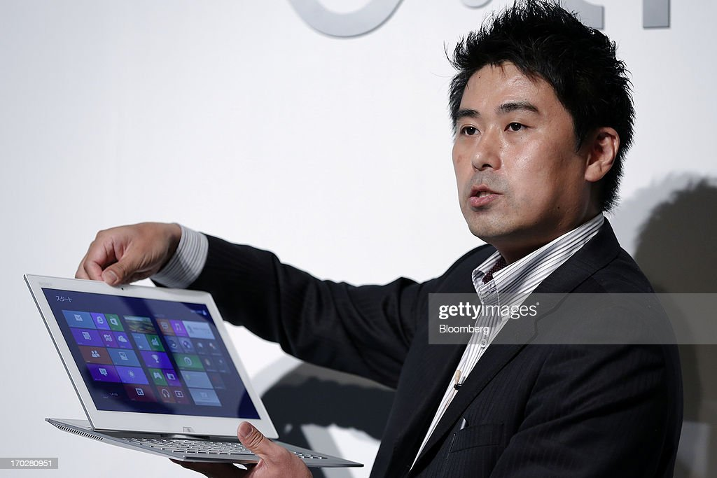 Kaya Kanamori, product planner at Sony Corp., holds the company's Vaio Duo Ultrabook laptop computer during a product launch in Tokyo, Japan, on Monday, June 10, 2013. Sony Corp. is Japan's biggest consumer-electronics exporter. Photographer: Kiyoshi Ota/Bloomberg via Getty Images