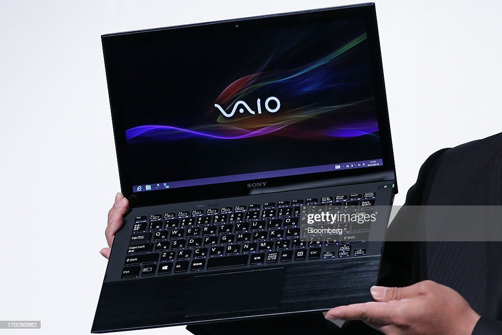 Kaya Kanamori, product planner at Sony Corp., holds the company's Vaio Pro Ultrabook laptop computer during a product launch in Tokyo, Japan, on Monday, June 10, 2013. Sony Corp. is Japan's biggest consumer-electronics exporter. Photographer: Kiyoshi Ota/Bloomberg via Getty Images