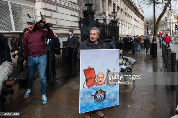 Kaya Mar an artist and painter presents his artwork on a day of the Spring Budget 2017 announcement on March 08 2017 in London England PHOTOGRAPH BY...