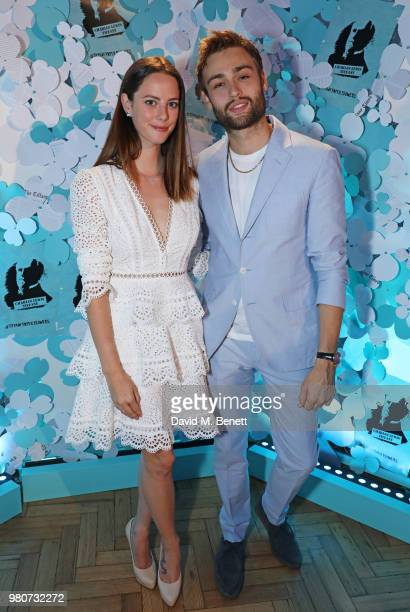 Kaya Scodelario and Douglas Booth attend as Tiffany Co celebrates the launch of the Tiffany Paper Flower collection at The Lindley Hall on June 21...