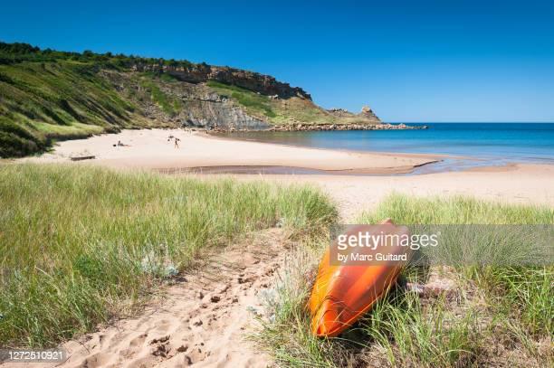 a kayak among the sand dunes at chimney corner beach, cape breton, nova scotia, canada - cape breton island stock pictures, royalty-free photos & images