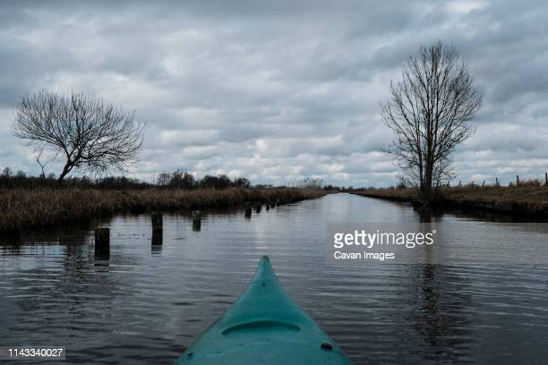 kayak in river against cloudy sky - overijssel stock pictures, royalty-free photos & images