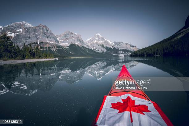 kayak on maligne lake, canadian rockies in background, jasper national park, canada - canadian flag stock pictures, royalty-free photos & images