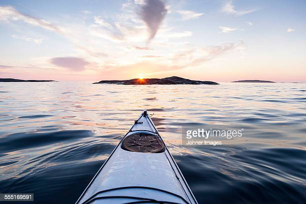 kayak on water at sunset - canoe stock pictures, royalty-free photos & images