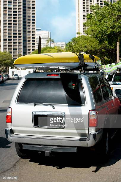 Kayak over a car, Honolulu, Oahu, Hawaii Islands, USA