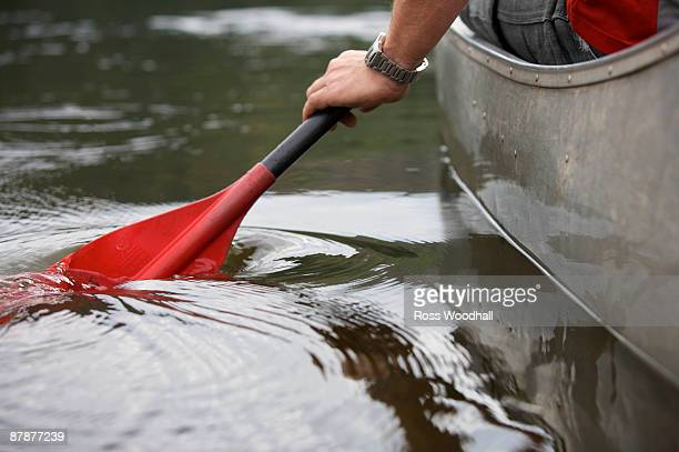 kayak paddle stroke in water. - paddle stock pictures, royalty-free photos & images