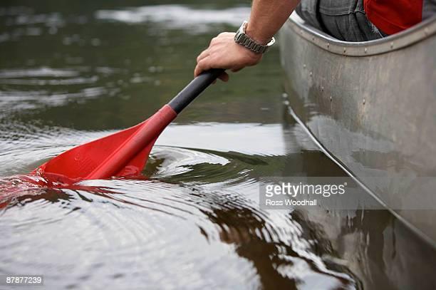 Kayak paddle stroke in water.