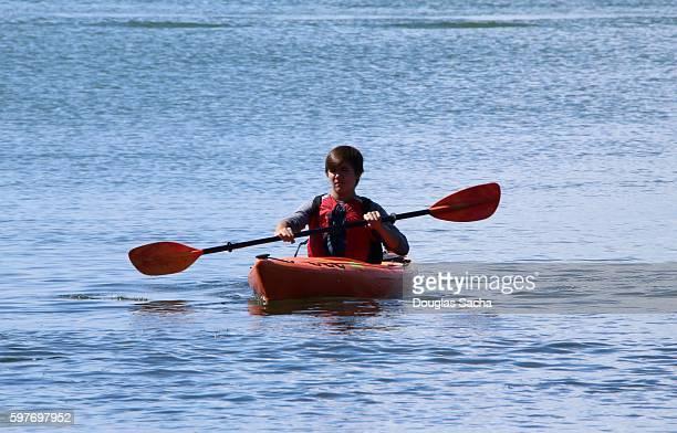 Kayak rider paddling his boat, East Harbor State Park, Marblehead, Ohio, USA