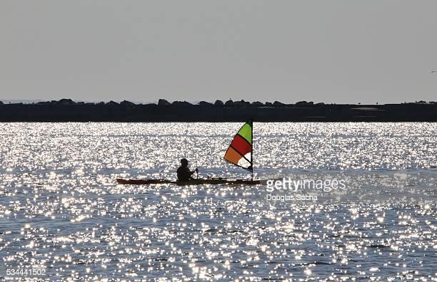 Kayak sailing along the lake shore