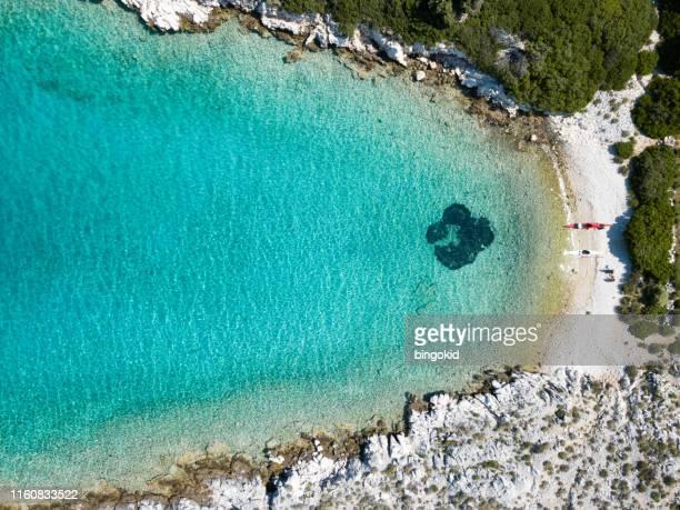 kayak sea trip to secret bay - sea kayaking stock pictures, royalty-free photos & images