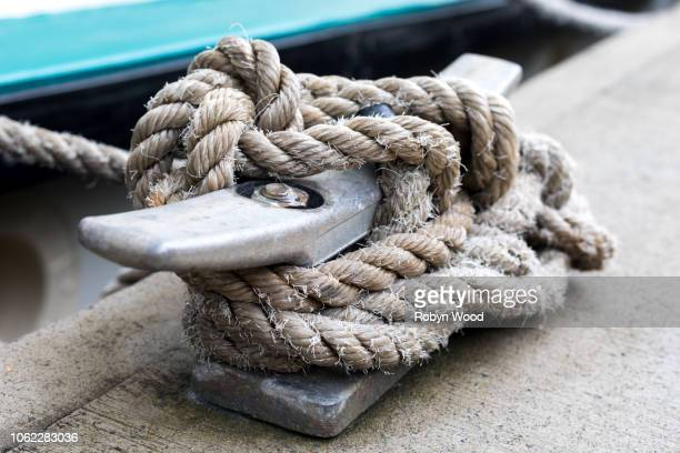 kayak tied to pontoon cleat with fishing knot. - sports training camp stock pictures, royalty-free photos & images