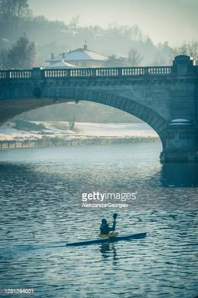 kayak under po river and bridge to gran madre church in turin italy - turin stock pictures, royalty-free photos & images