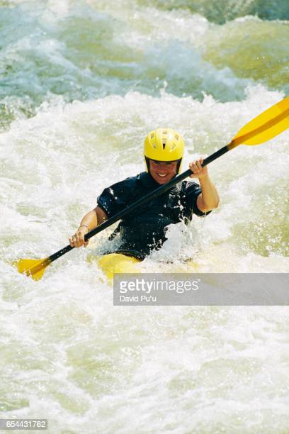 Kayaker Amidst Choppy Water