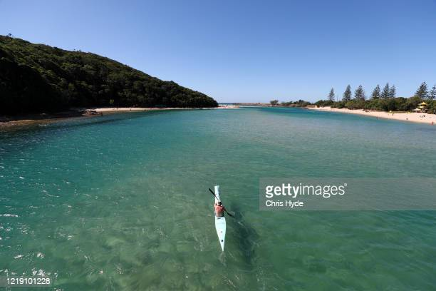 A kayaker enjoys Tallebudgera creek on April 16 2020 in Gold Coast Australia The Federal Government has closed all nonessential business and...