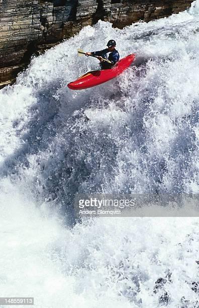 Kayaker flying over waterfall on Store Ula River near Otta.